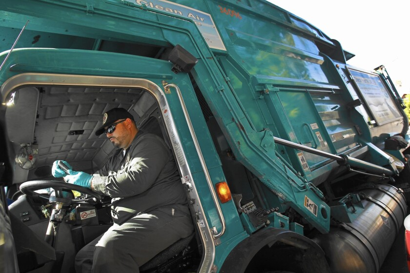 L.A. sanitation department driver Adrian Tornero uses a new GIS-based smartphone app, instead of Thomas Guides, when picking up unwanted furniture.