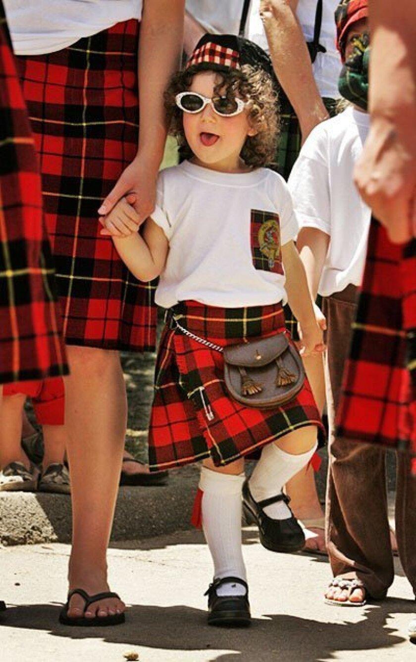 Alaina Wallace, 2, of Topsfield, Mass., sported her highland attire at Vista's Brengle Terrace Park. (Howard Lipin / Union-Tribune)