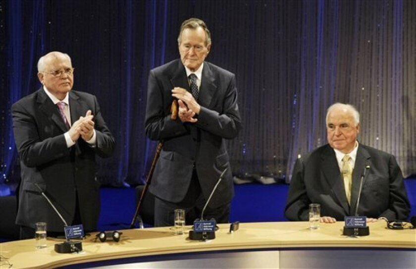 The last Soviet leader, Mikhail Gorbachev, former U.S. President George H.W. Bush and former German Chancellor Helmut Kohl , from left to right, applaude during an event in Berlin, Germany, Saturday, Oct. 31, 2009, marking the start of celebrations here recalling the crumbling of the Berlin wall on Nov. 9, 1989. (AP Photo/Herbert Knosowski)