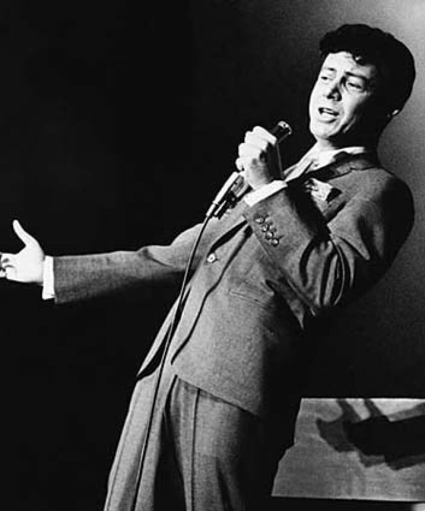 Making his comeback as a singer, Eddie Fisher performs at the Desert Inn in Las Vegas. See full story