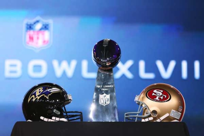 Super Bowl XLVII: The Baltimore Ravens vs. the San Francisco 49ers: Sunday 3:25 p.m. CBS. Pictured: The Vince Lombardi Trophy and team helmets.