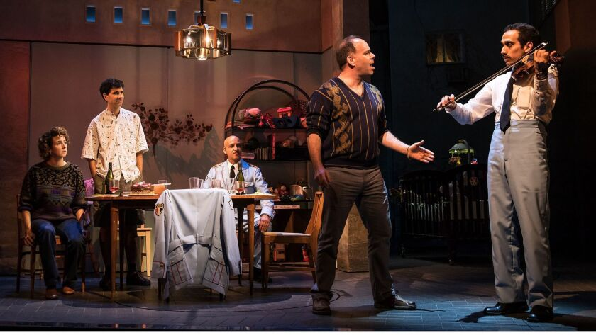 """From left, Kristen Sieh, John Cariani, Alok Tewari, Andrew Polk and George Abud in """"The Band's Visit."""""""