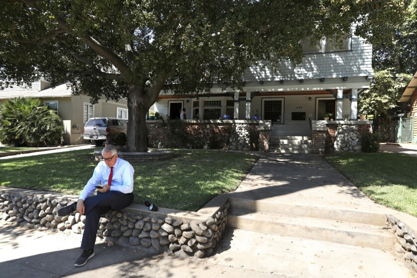 PASADENA, CA - AUGUST 31, 2018 - A reporter sits in front of the home where actress Vanessa Marquez