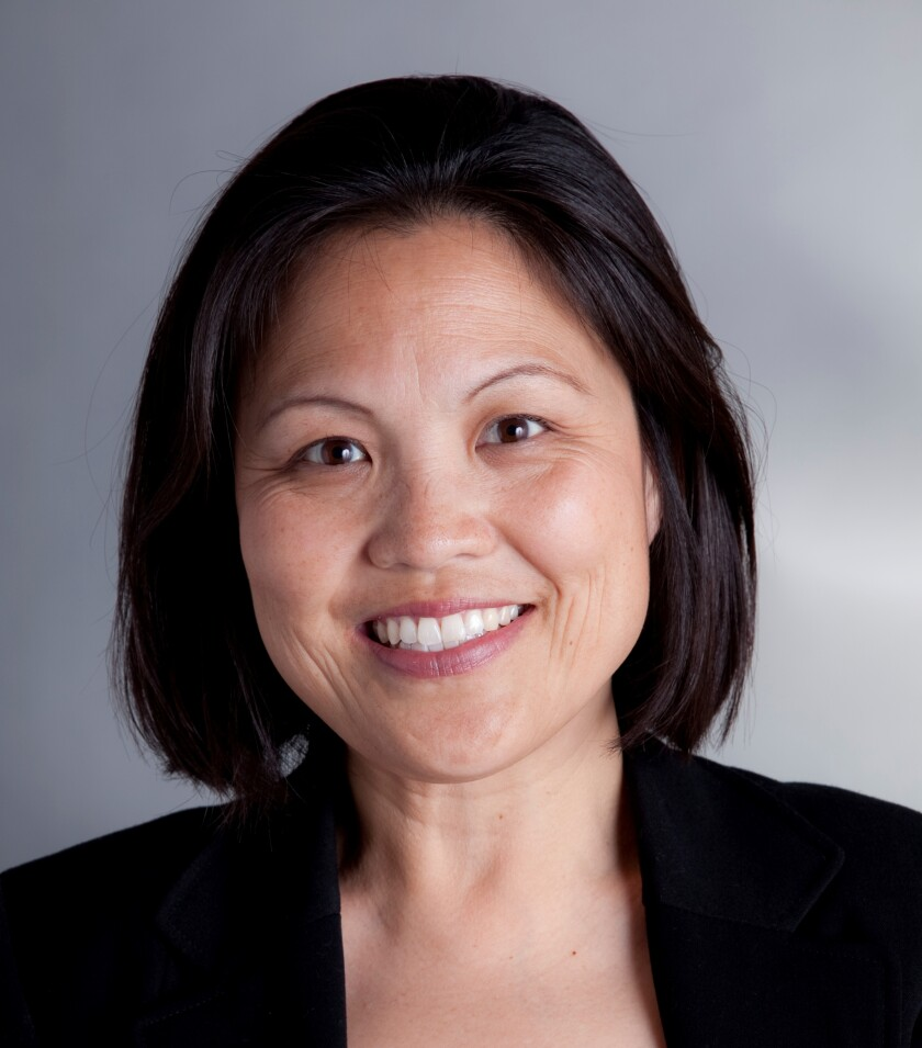 California Labor Secretary Julie A. Su smiles in a headshot