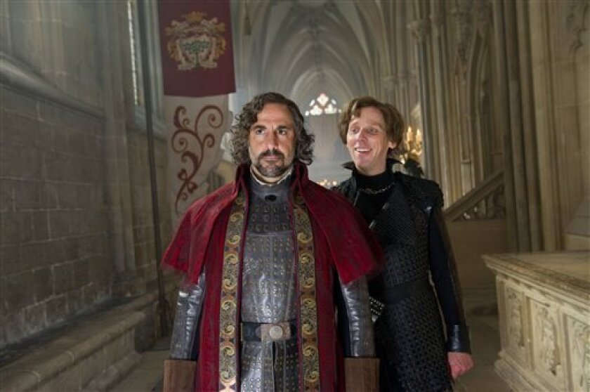 """This film image released by Warner Bros. Pictures shows Stanley Tucci, left, and Ewen Bremner in a scene from """"Jack the Giant Slayer."""" (AP Photo/Warner Bros. Pictures, Daniel Smith)"""