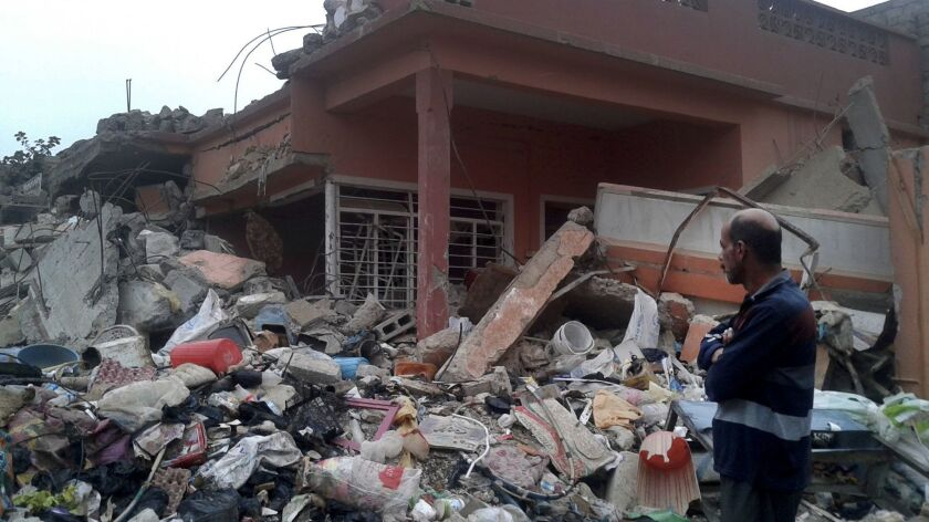 Mosul, Iraq, Nov. 8, 2017 _ Mohammed Fadhil surveys the site where more than 100 people were killed