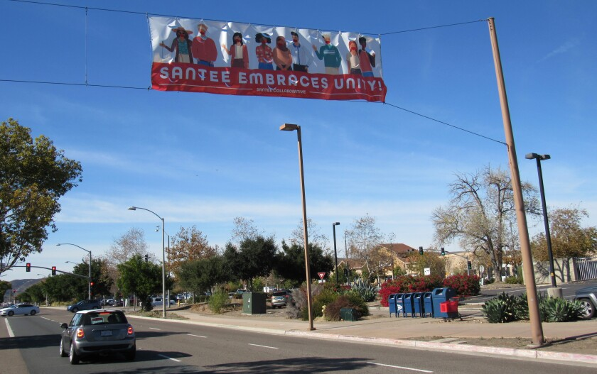 One of two banners hanging along Mission Gorge Road by the Santee Post Office shows efforts to be more inclusive.