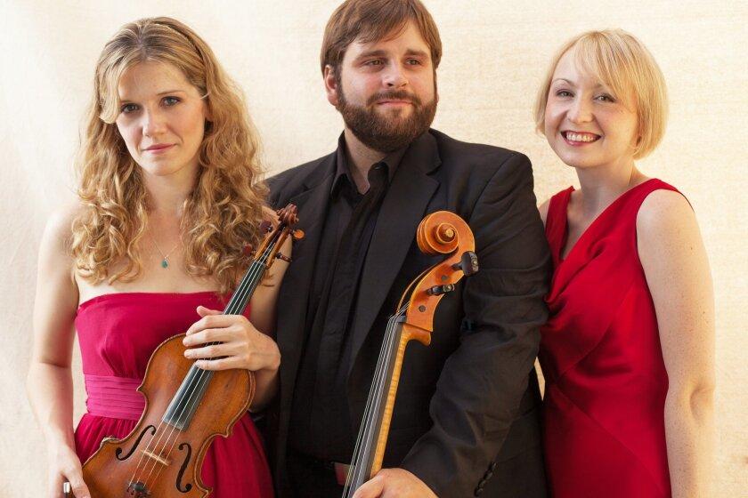 The members of the Neave Trio are violinist Anna Williams, cellist Mikhail Veselov, and pianist Toni James.