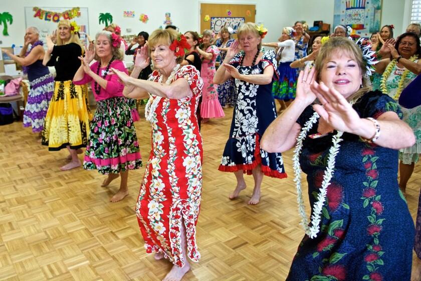 Christinia Pualani Lee's Hawaiian dance class practicing at the Carlsbad Senior Center.