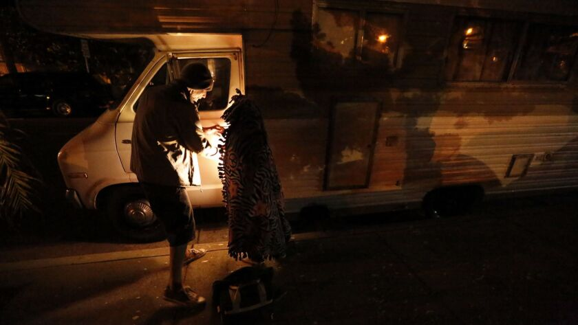 Safe parking programs give those without shelter a spot where they can spend the night in their vehicles. Thomas Goodwin and his daughter Leilani Miranda Duenez Goodwin, above, participate in a program in Santa Barbara.