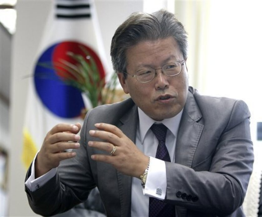 In this June 10, 2010, photo, Lee Young-jo, president of South Korea's Truth and Reconciliation Commission, gestures during an interview with The Associated Press in Seoul, South Korea. In a political about-face, the commission, investigating the U.S. military's large-scale killing of refugees and