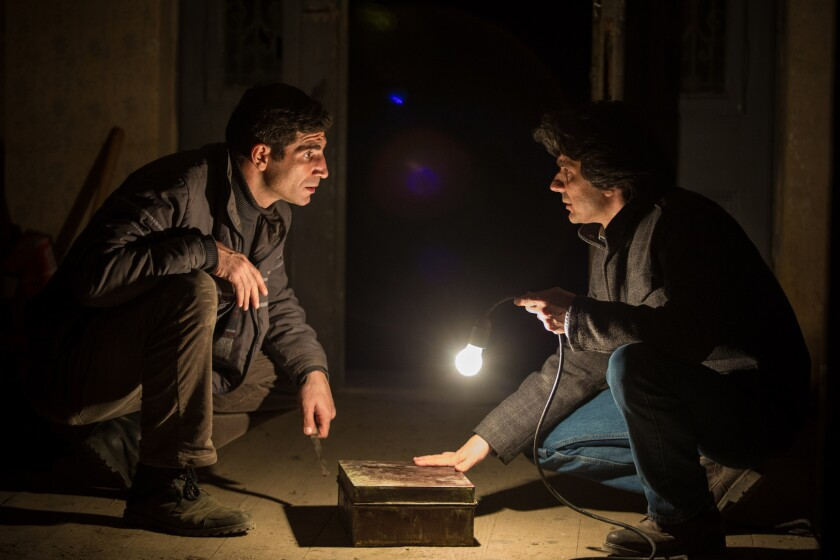 """Actor Cuzin Toma as Costi, left, and Adrian Purcarescu as Adrian in """"The Treasure."""""""