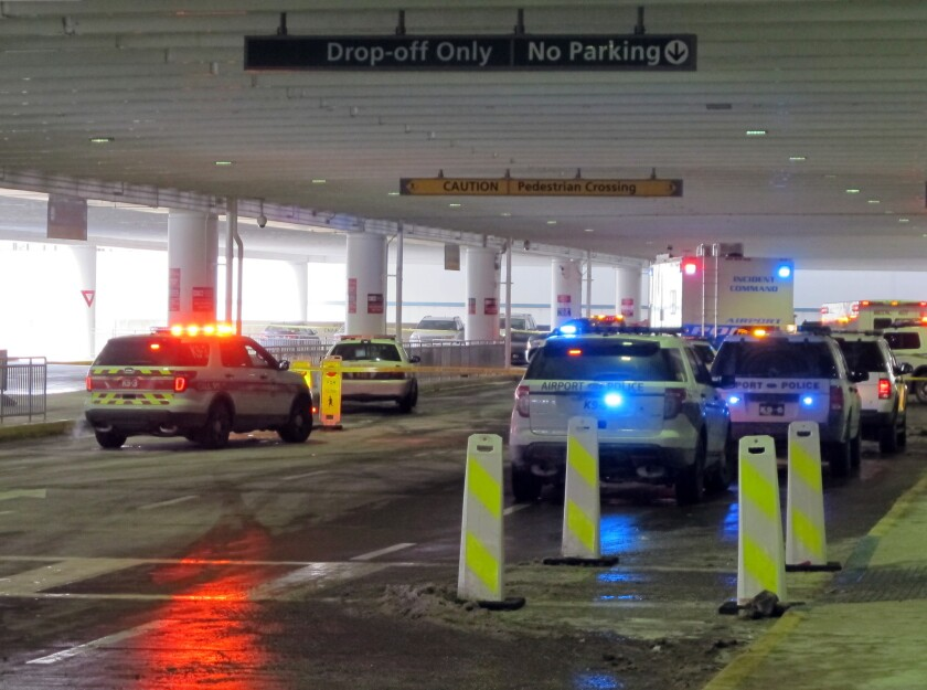 Emergency vehicles converge at the ticketing level at Port Columbus International Airport after officials say an airport police officer shot and killed a man after a confrontation.