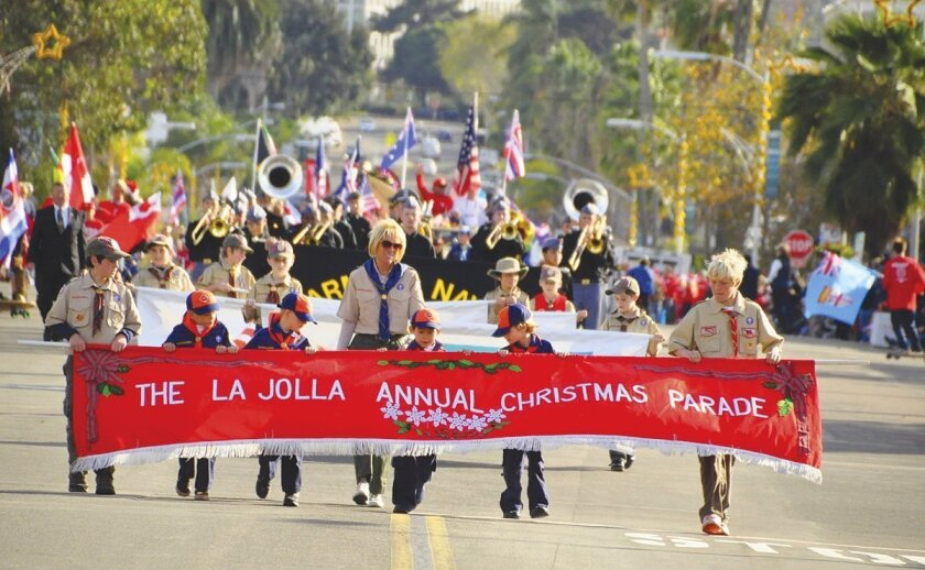 An opening scene from the 56th annual La Jolla Christmas Parade down Girard Avenue on Dec. 8, 2013.