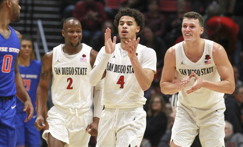 San Diego State entered Tuesday unbeaten and No. 7 in the country, behind a deep roster that includes Yanni Wetzell, right, Trey Pulliam, center, and Adam Seiko.