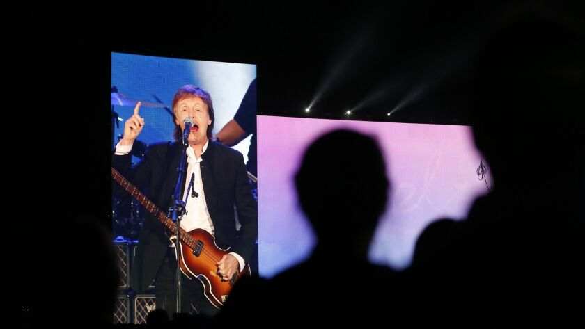 INDIO, CALIF. -- SATURDAY, OCTOBER 8, 2016: Fans watch Paul McCartney performs on the big screen on
