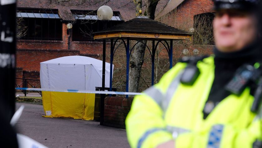 A police tent covers the spot in Salisbury, England, where former Russian spy Sergei Skripal, 66, and his 33-year-old daughter, Yulia, were found unconscious.