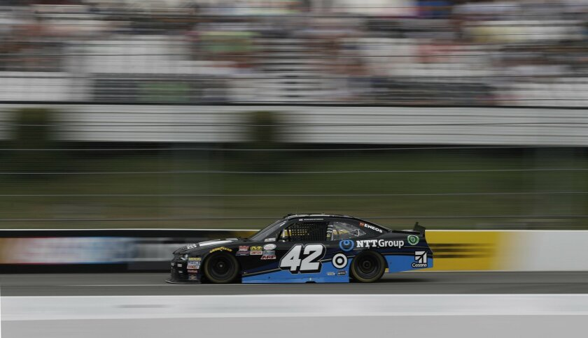 Kyle Larson drives down the front stretch during the NASCAR Xfinity series auto race at Pocono Raceway, Saturday, June 4, 2016, in Long Pond, Pa. (AP Photo/Matt Slocum)