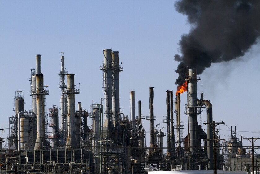 Black smoke rises in the sky during a non-emergency flaring operation at the ConocoPhillips refinery in Wilmington last year.