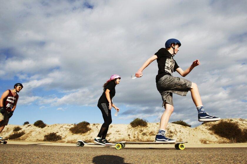 Skateboarders compete in the Adrenalina Skateboard Marathon on Fiesta Island.