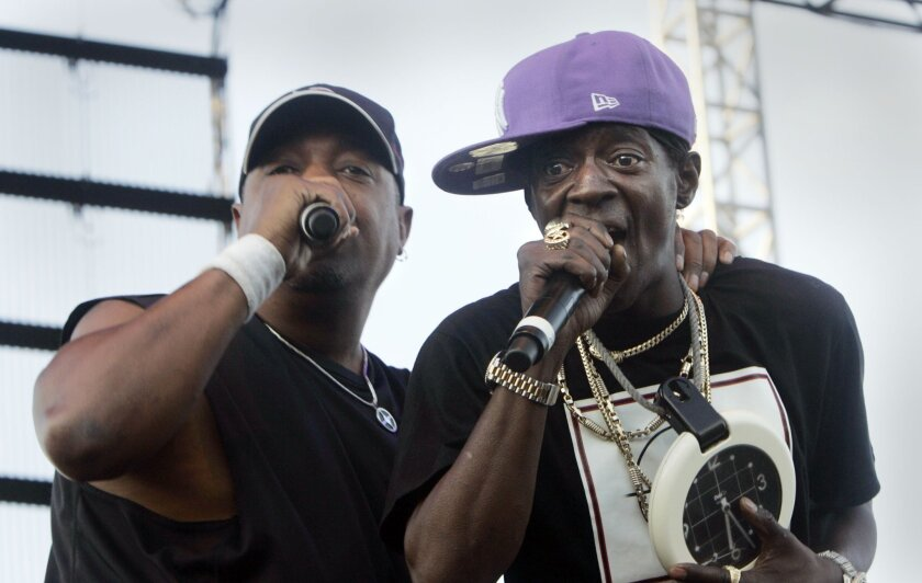 "Co-leaders Chuck D and Flavor Flav of the New York hip-hop group Public Enemy wrapped up their performance with the combustible ""Fight the Power."" (Peggy Peattie / Union-Tribune)"