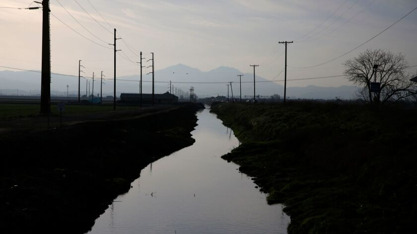A waterway that connects to the Sacramento-San Joaquin River Delta runs along Route 4, just outside Stockton.