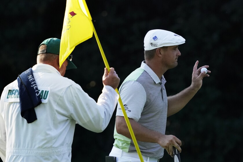 Bryson DeChambeau holds up his ball after a birdie on the sixth hole during the second round of the Masters.