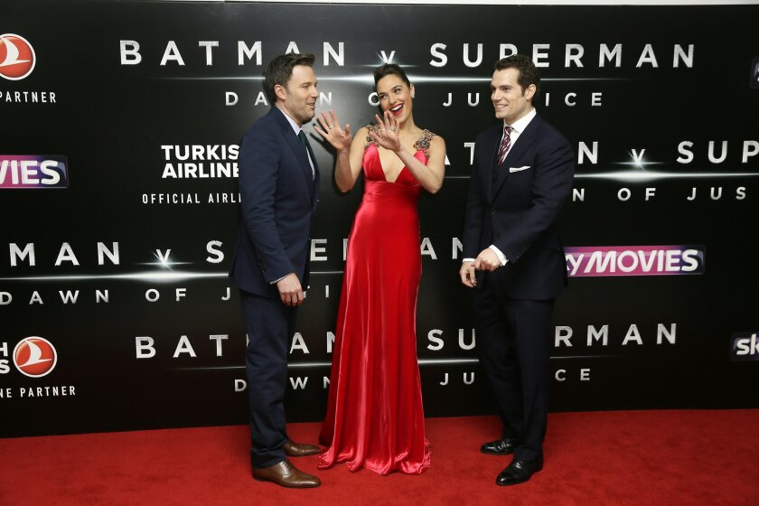 Actors Ben Affleck, from left, Gal Gadot and Henry Cavill pose for photographers upon arrival at the premiere of the film 'Batman V Superman' in London, Tuesday, March 22, 2016. (Photo by Tim Ireland/Invision/AP)