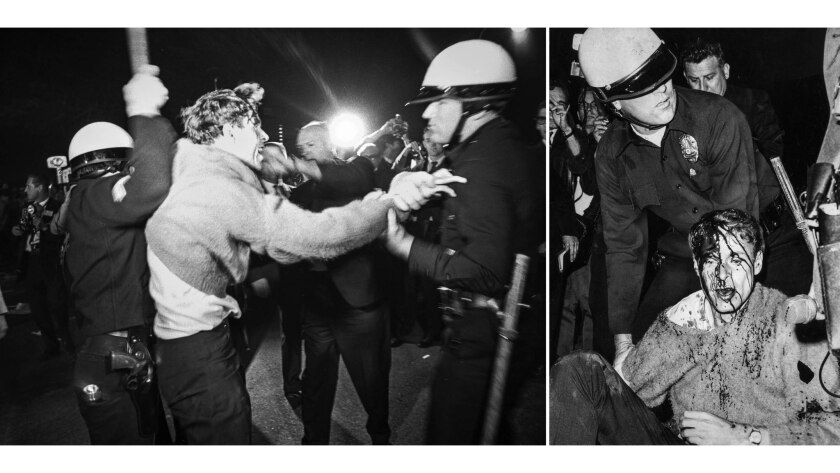 June 23, 1967: Young man, left, resists police demands to disperse during anti-war protests at Centu