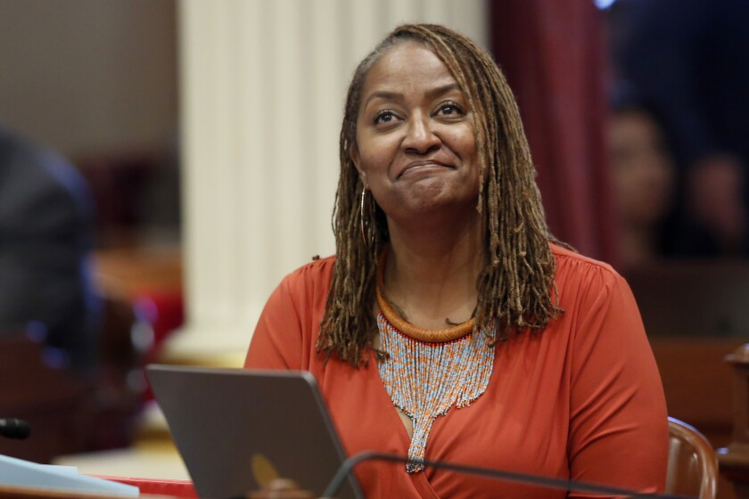 FILE - In this July 8, 2019 file photo, state Sen. Holly Mitchell, D-Los Angeles, reacts in the Senate chamber in Sacramento, Calif. Los Angeles County voters were favoring Assemblywoman Sydney Kamlager in a special election to replace former state Sen. Mitchell, who left in mid-term for the county board of supervisors. Early election returns Tuesday, March 2, 2021, showed Kamlager, with an edge in the seven-candidate field in the 30th Senate District. (AP Photo/Rich Pedroncelli, File)