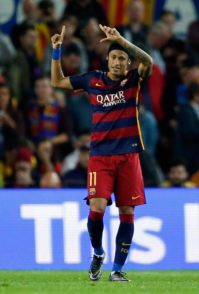 Barcelona's Neymar celebrates after scoring his side's third goal during the Champions League Group E soccer match between FC Barcelona and BATE Borisov at the Camp Nou stadium in Barcelona, Spain, Wednesday, Nov. 4, 2015. (AP Photo/Manu Fernandez)