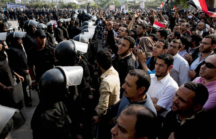 Egypt court postpones ruling as protesters mass at chambers