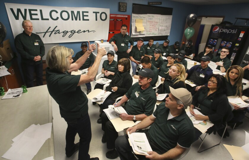 New employees attend an orientation session the day before the grand opening of a Palmdale Haggen grocery store, formerly an Albertsons, on March 23.