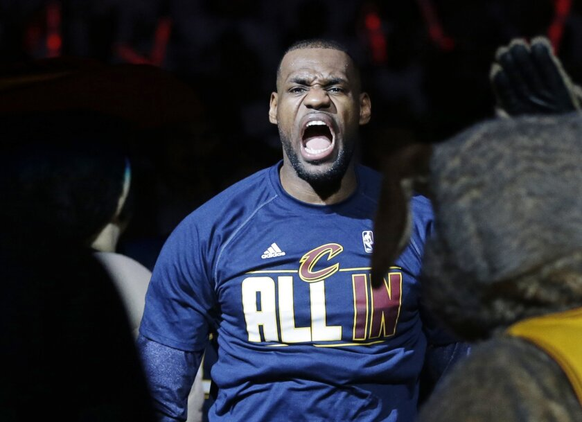 Cleveland Cavaliers' LeBron James is introduced before a first round NBA playoff basketball game against the Boston Celtics, Sunday, April 19, 2015, in Cleveland. (AP Photo/Mark Duncan)