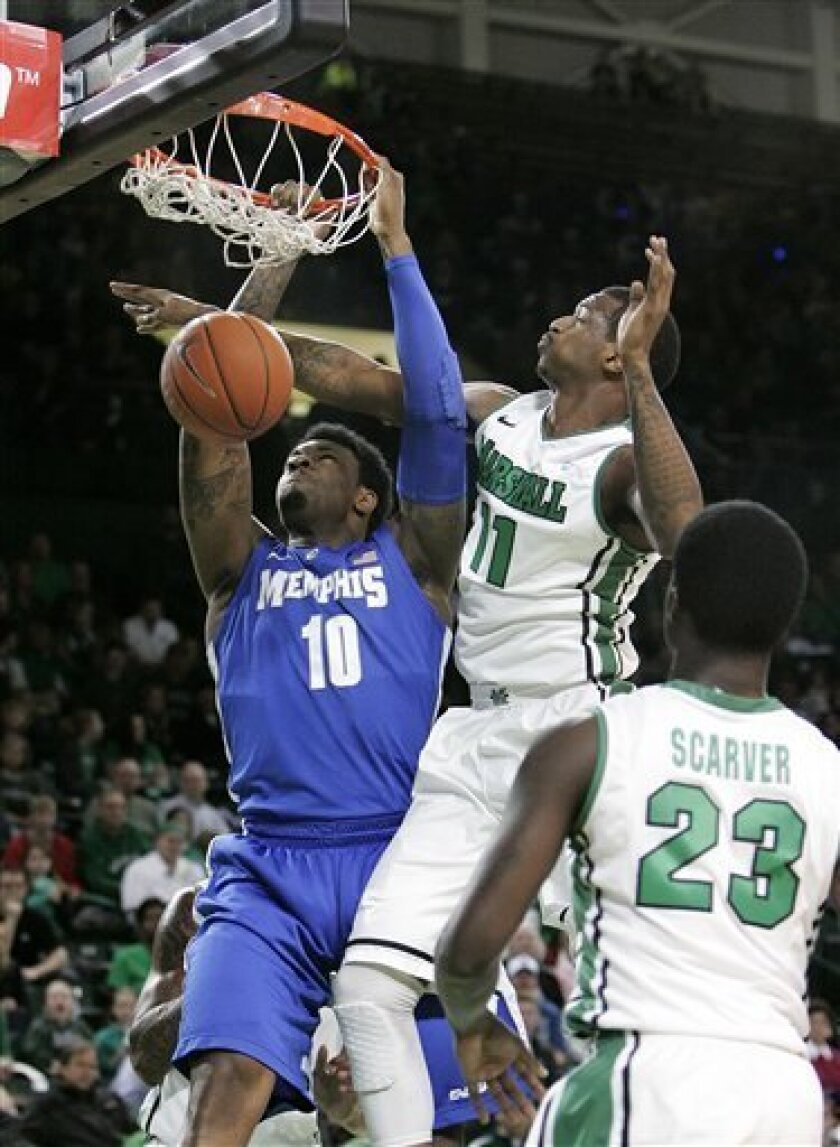 Marshall's D.D. Scarver (23) watches as teammate Nigel Spikes, top right, is unable to block a dunk by Memphis' Tarik Black during the first half of an NCAA college basketball game on Saturday, Feb. 16, 2013, at the Cam Henderson Center in Huntington, W.Va. (AP Photo/Randy Snyder)