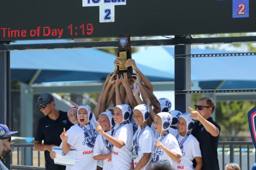 Del Mar Water Polo Club's 12 & under Boys A team members celebrate their national championship.