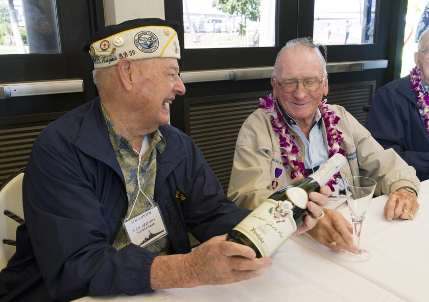 USS Arizona survivors including Louis Conter, left, and Donald Stratton planned to toast their fallen comrades Sunday on the anniversary of the Pearl Harbor attack.