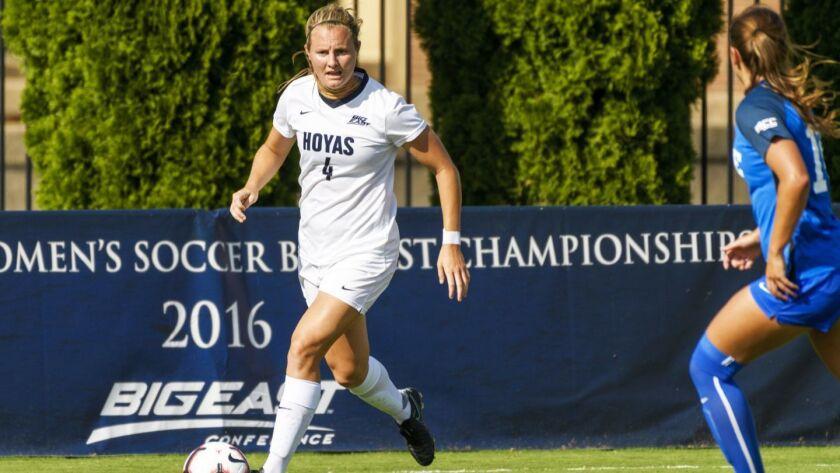 Women's Soccer vs Duke User Upload Caption: Titan water polo leader Kyra Carusa in action.