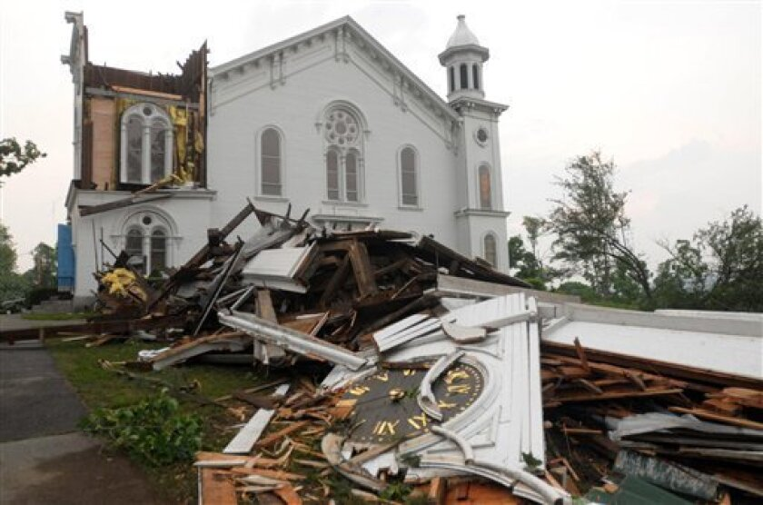 The steeple of The First Church of Monson lays in rubble on the ground after a tornado swept through the downtown area of Monson, Mass., Wednesday, June 1, 2011. (AP Photo/Worcester Telegram & Gazette, Tom Rettig)