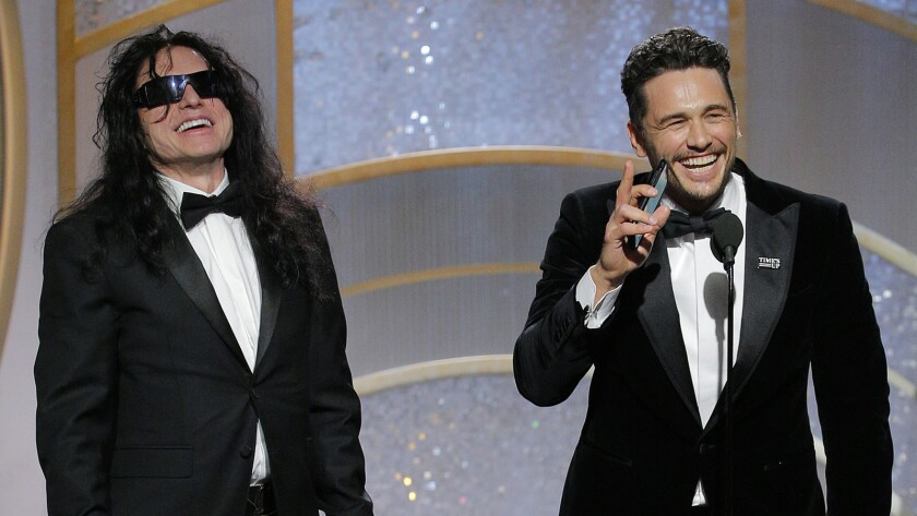 """Tommy Wiseau and James Franco share the stage as Franco accepts the award for performance by an actor in a motion picture musical or comedy for """"The Disaster Artist."""""""