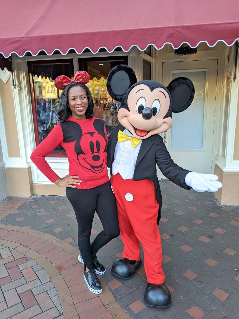 Tiffanie Sojourner, 34, of La Mesa enjoys a visit with Mickey Mouse at Disney California Adventure Park in Anaheim. Sojourner was recently appointed as an adviser on the Disney Parks Moms Panel.