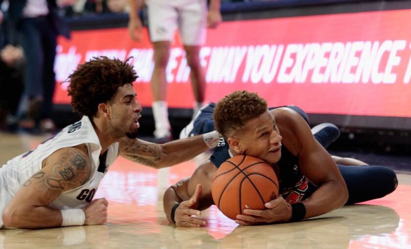 Pepperdine's Kameron Edwards, right, battles Gonzaga's Josh Perkins in 2018.
