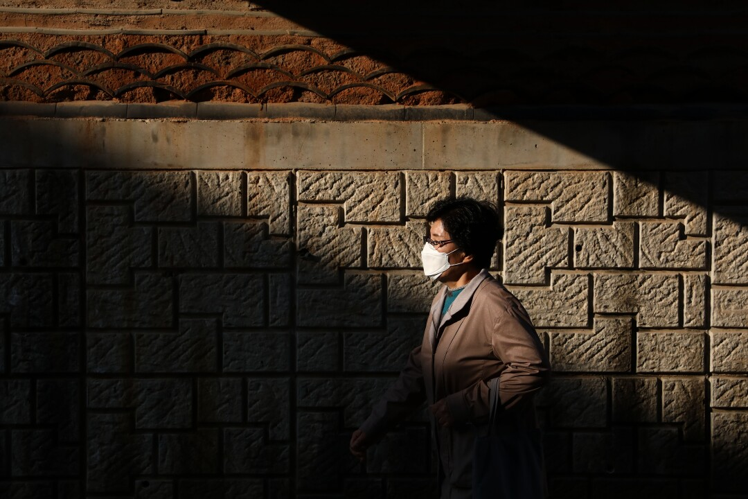 A woman walks in Seoul, where isolation had become a trend even before the coronavirus pandemic.
