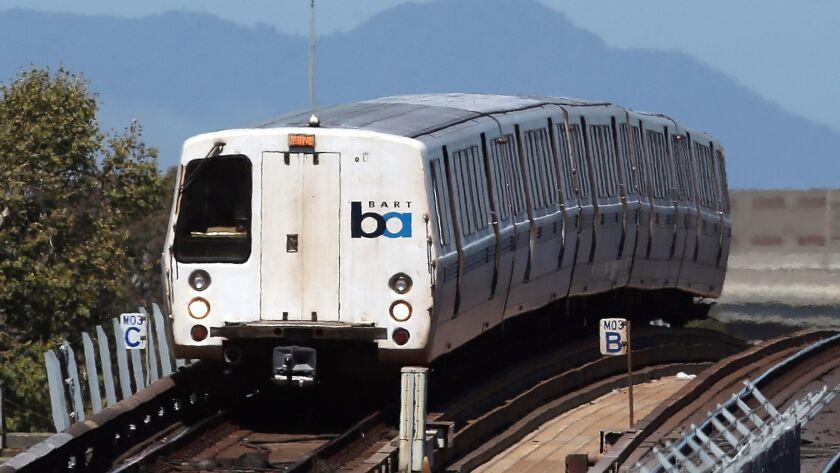A BART train travels toward downtown Oakland.