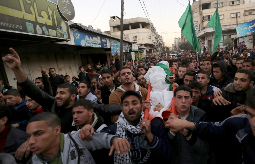 Mourners carry the body of Bilal Samer Oweidah during his funeral in Beit Lahiya, in the northern Gaza Strip. He was shot by Israeli troops during a violent protest along the border with Israel.