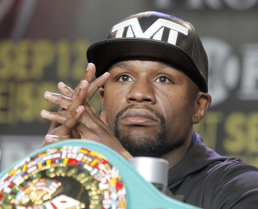 Floyd Mayweather Jr. takes questions during a news conference in Los Angeles on Thursday, Aug. 6, 2015. Mayweather is scheduled to face Andre Berto in a boxing bout Sept. 12 in Las Vegas.