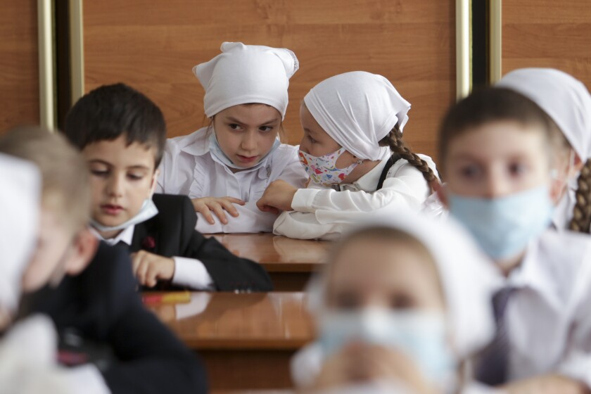 Pupils wear face masks in Grozny, Russia