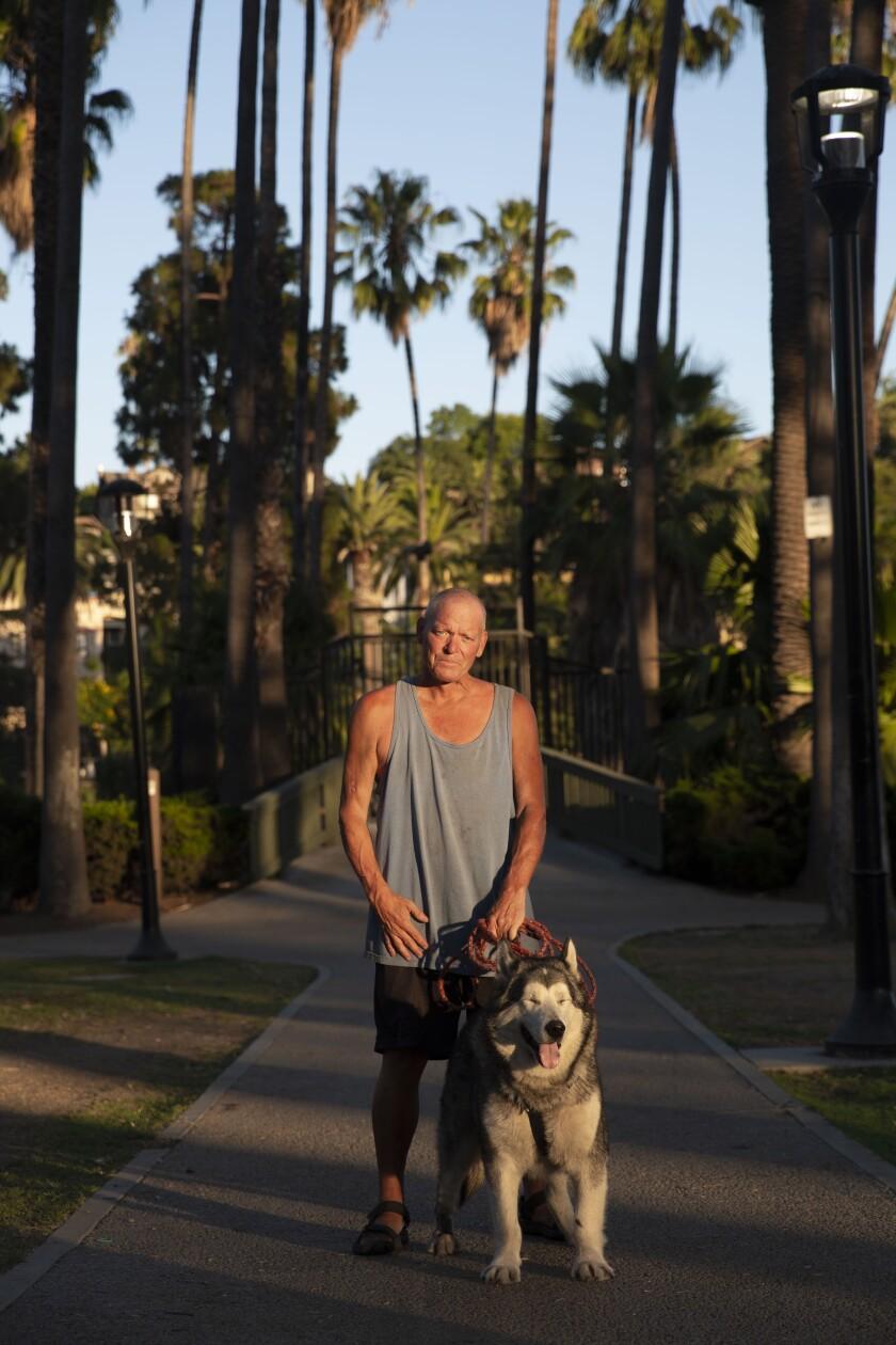 Homeless veteran Shane Isaacson with his dog