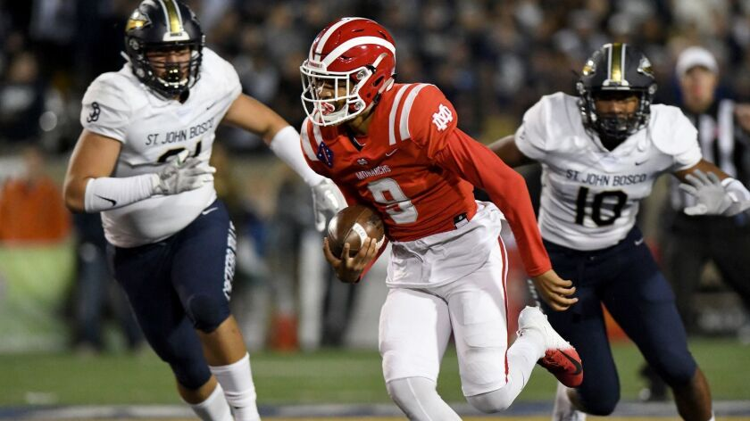 Mater Dei quarterback Bryce Young finds running room against St. John Bosco during their Trinity League game last season.
