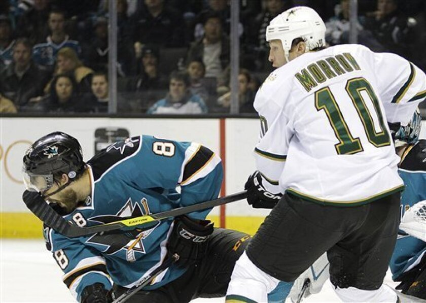 Dallas Stars' Brenden Morrow (10) hits San Jose Sharks' Brent Burns in the face with his stick during the first period of an NHL hockey game Saturday, March 31, 2012, in San Jose, Calif. (AP Photo/Ben Margot)